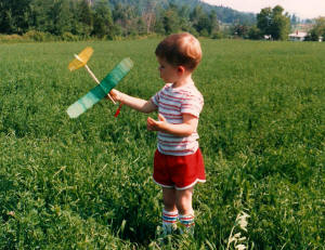 Philip Blattenberger with Comet Cadet rubber-powered airplane, Hinesburg, Vermont, circa 1988 - Airplanes and Rockets