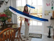 Supermodel Melanie Blattenberger holding my modified Great Planes 2-meter Spirit glider