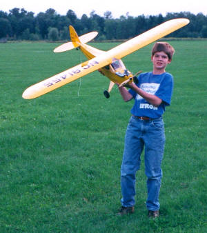 Philip Blattenberger holding my Great Planes J-3 Cub 20 (1996, Syracuse, New York) - Airplanes and Rockets
