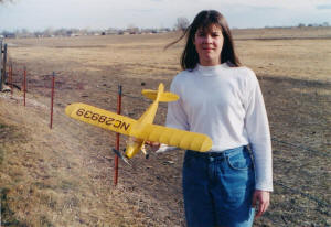 Sally Blattenberger (now Sally Cochran) holding her Comet J-5 Cub Cruiser - Airplanes and Rockets