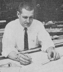 Seymour Glassner has a mighty serious look on his face when he's behind his drafting board  - Airplanes and Rockets