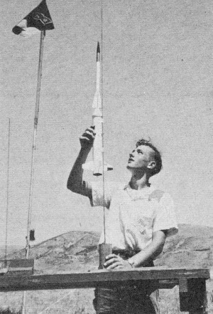 Joe Wald loads scale 2-stage miniature Cooper-Marquardt ASPAN sounding rocket at NARAM-3 - Airplanes and Rockets