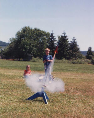 Philip launches his Estes Alpha while Sally watches - Smithsburg, MD - Airplanes and Rockets